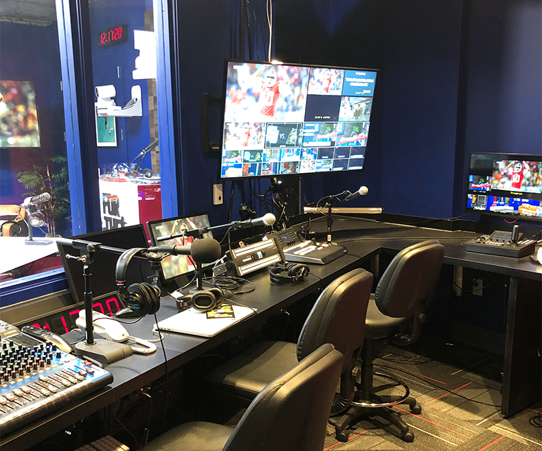 a podcast studio multicamera live video production control room for livestreaming broadcast and OTT with multiviewer visible comms and AW-RP150 roboitc pro ptz controller