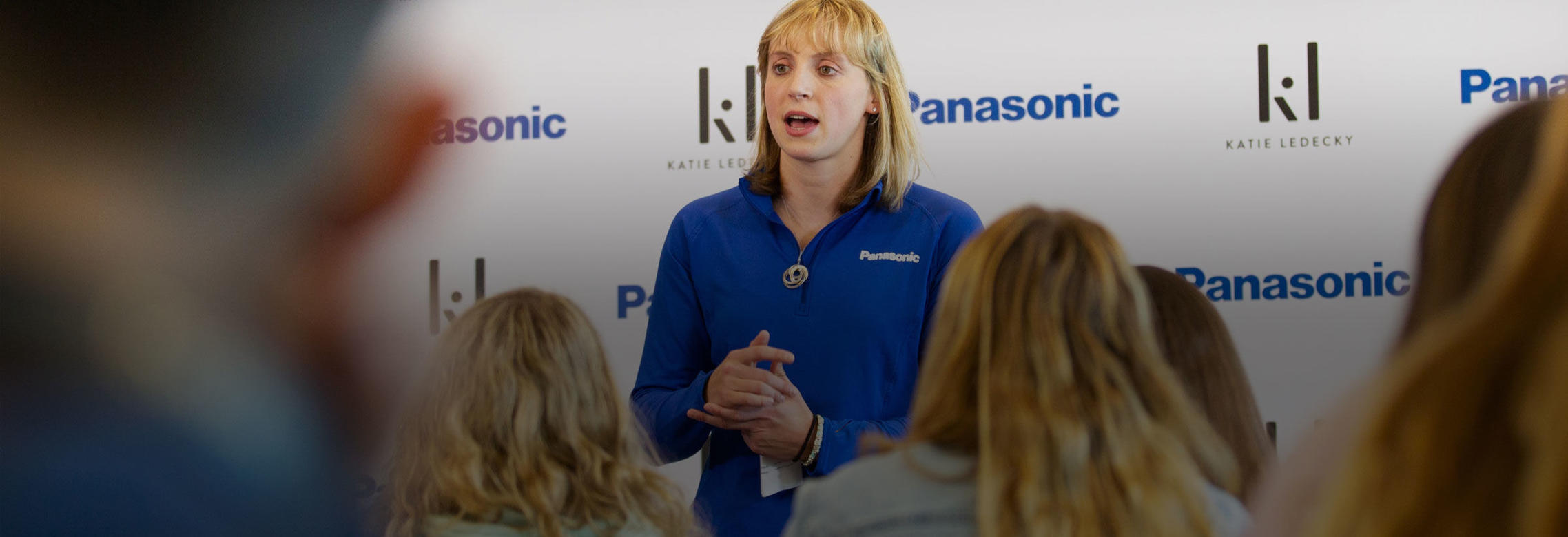 Katie Ledecky speaks to a group of students
