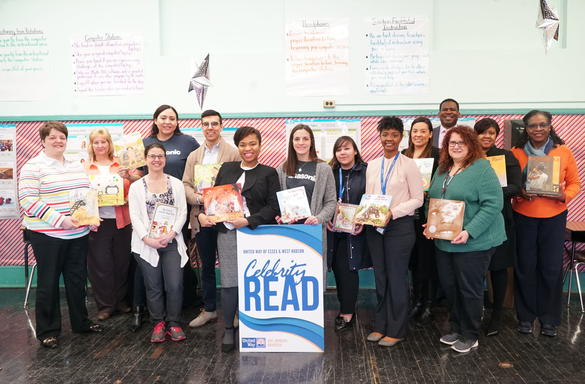 Panasonic volunteers read to students at Avon Avenue Elementary School