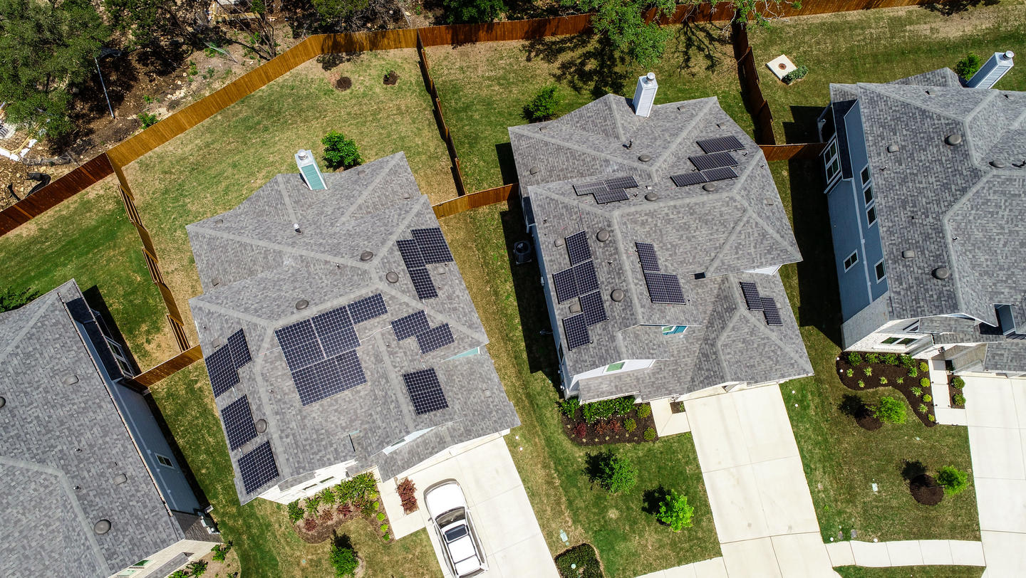 solar panel homes at New urban Suburb development North Austin homes and grey modern rooftops