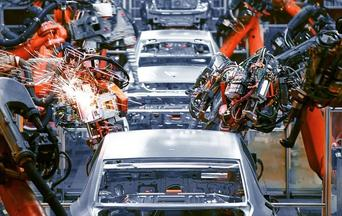 cars on an automated assembly line