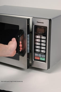 Close up of hand opening microwave door