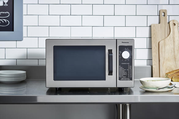 microwave on countertop with food head on