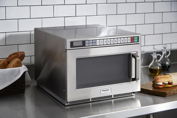 Microwave on countertop side view with food