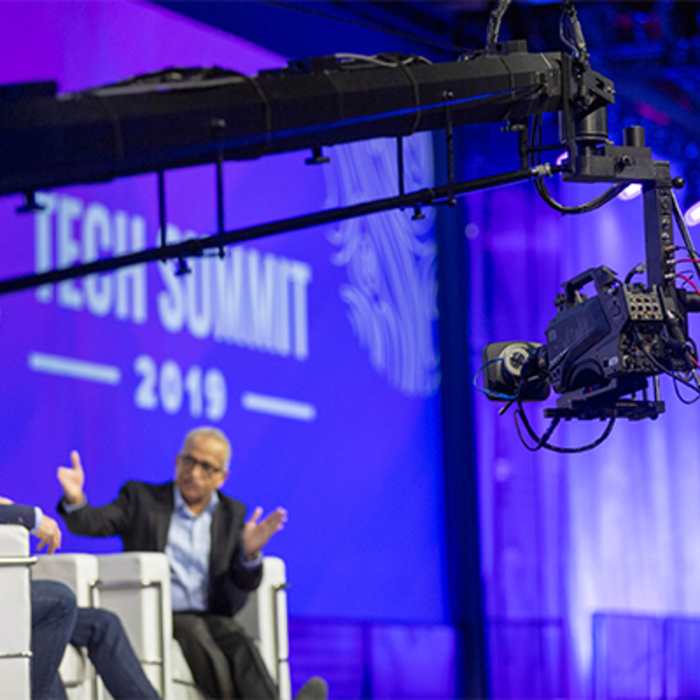 Best live production camera system for corporate events is the Panasonic AK-UC3000, shown here capturing a stage on a jib crane