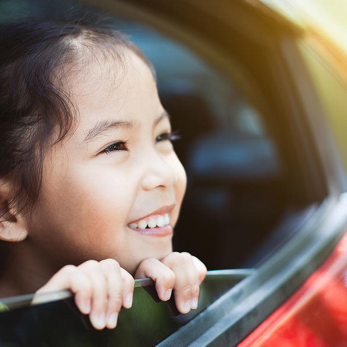 girl smiling in a car