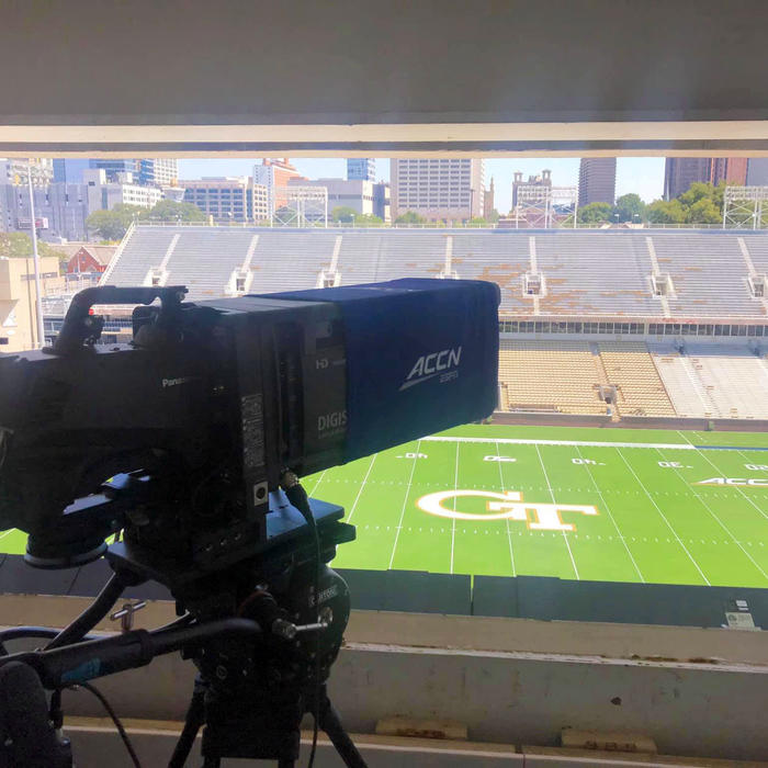 professional broadcasting camera capturing a college football game