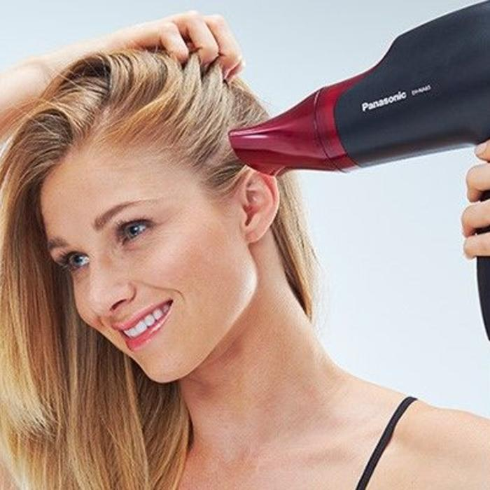 woman using panasonic hairdryer