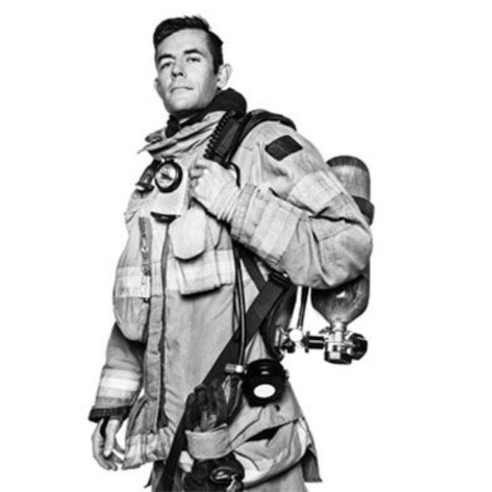 Black and white portrait of firefighter with gear