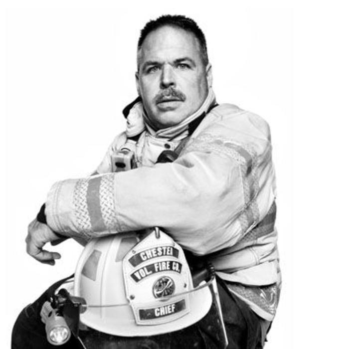 Black and white portrait of firefighter with helmet