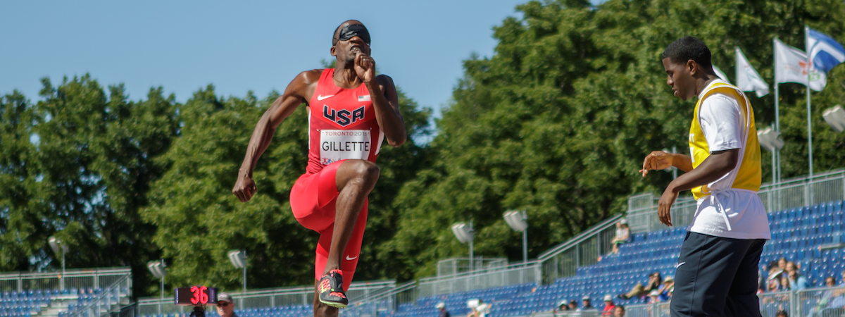 Lex Gillette prepares to transition from the run-up to the take-off of his long jump